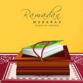 stock photo of quran  - Religious Islamic Book Quran Shareef with praying mantis on wooden stand concept for holy month of Muslim community Ramadan Kareem celebrations - JPG