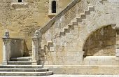 stock photo of swabian  - Wonderful stone staircase in the courtyard of the Swabian castle of Gioia del Colle  - JPG