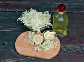 pic of elderberry  - Syrup of flowers elderberry on wooden table - JPG