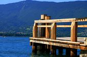 foto of annecy  - Empty wooden pier on Annecy blue clear lake - JPG