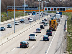 image of noise pollution  - cars on a highway with a speed limit icon photos of transport - JPG
