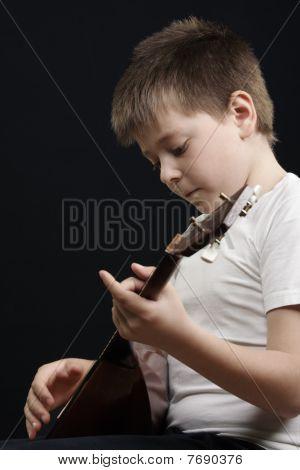 Kid Playing Balalaika