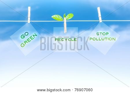 Three green road sign hanging on blue sky background, go green, recycling of garbage, stop pollution, save environment concept