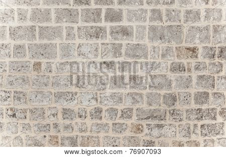 Gray brick background, grunge style brickwork wall, stylish modern architecture detail, building exterior, stonewall texture