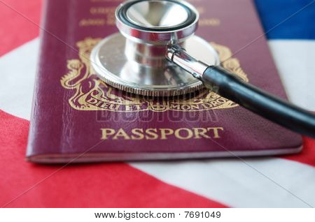Passport and stethoscope on flag.