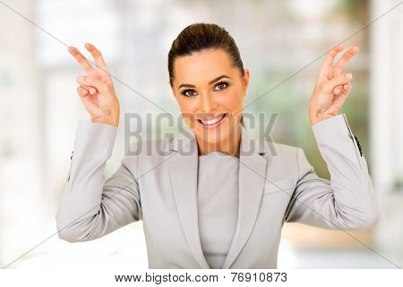 beautiful young career woman showing quote hand sign