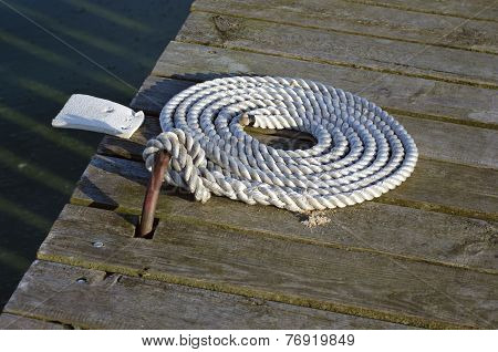 Nautical Mooring Rope On Wooden Pier