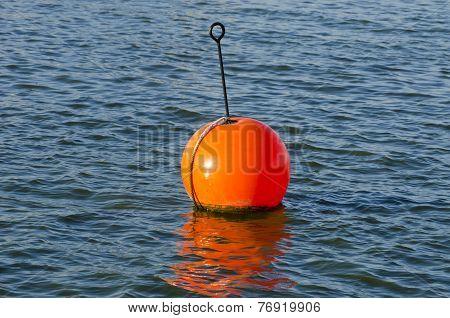 Orange Buoy In  Sea