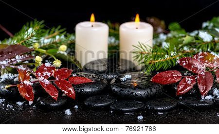 Winter Spa Concept Of Evergreen Branches, Red Leaves With Drops, Snow,  Candles On Zen Basalt Stones