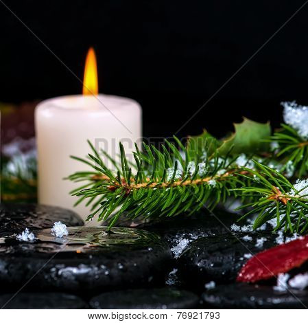 Winter Spa Concept Of Evergreen Branches With Drops, Snow,  Candle On Zen Basalt Stones, Closeup