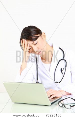 Young Japanese female doctor worries about something