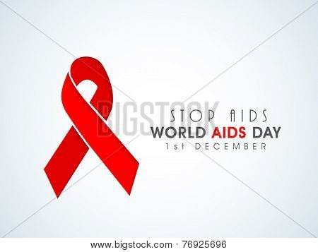 Red ribbon of aids awareness with text for 1st December World Aids Day concept.