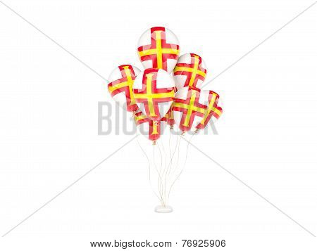 Flying Balloons With Flag Of Guernsey