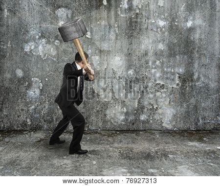 Businessman Hold Sledgehammer To Crack Old Mottled Concrete Wall