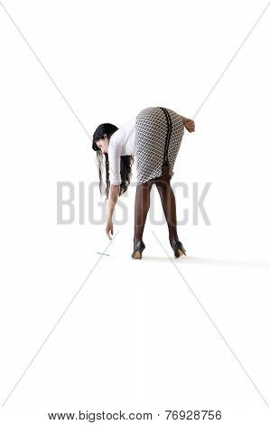 Young attractive business woman picking pencil up off floor