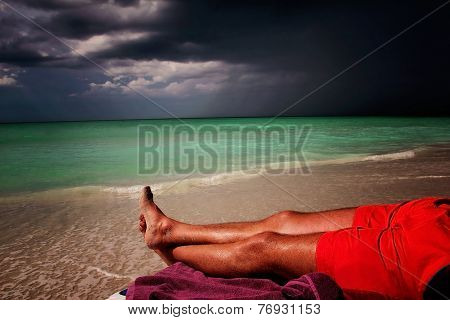 Man Enjoying Sunset  at the Beach before the Storm