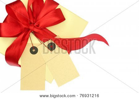 Gift box with two blank tags and ribbon isolated