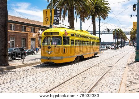 The orange yellow tram in San Francisco