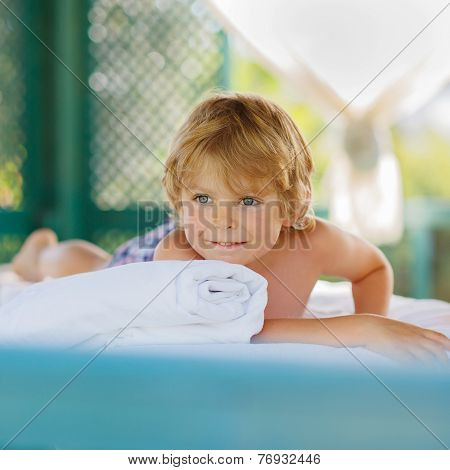 Little Kid Boy Relaxing In Spa With Having Massage