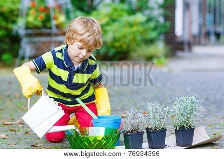 Funny Little Boy Planting Flowers In Home's Garden
