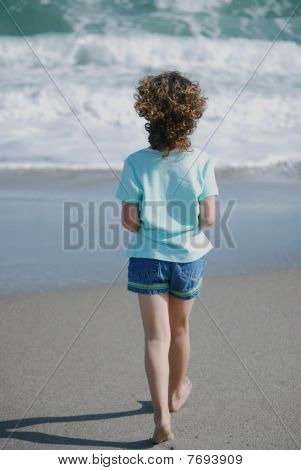 Girl Walking the Beach