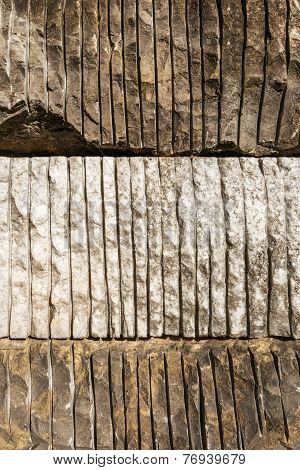 Rocks with sawn stripes