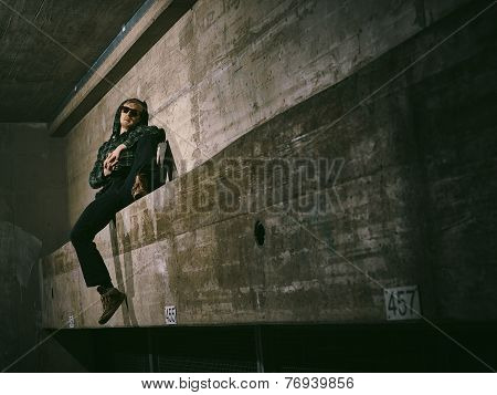 Young Man And Concrete Wall