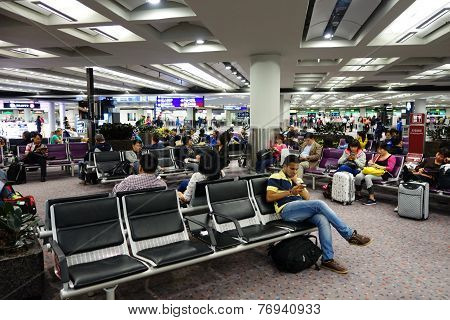 Passengers Wait For The Transit Flight The Airport Lobby Of Hong Kong Airport
