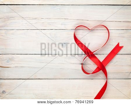 Valentines day background with heart shaped ribbon over white wooden table background