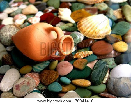 little amphora on marine stones