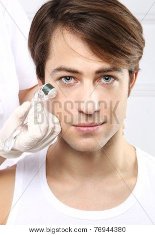 Handsome man at the beautician, micro needle mesotherapy treatment
