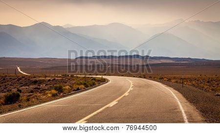 Curvy Road Leading To The Mountain