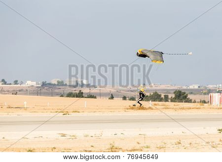Athlete Man Parachutist A Touchdown