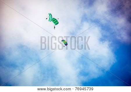 Three Parachutist Fly