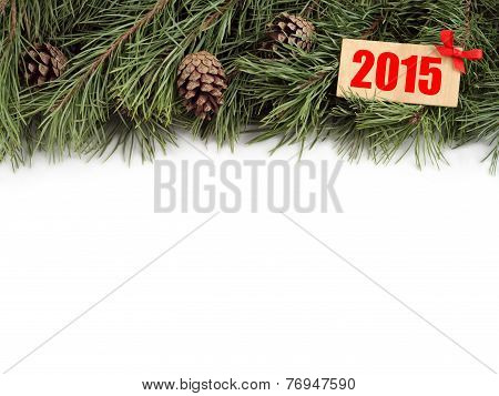 New Year background. Christmas fir tree and bumps with wooden plate with text