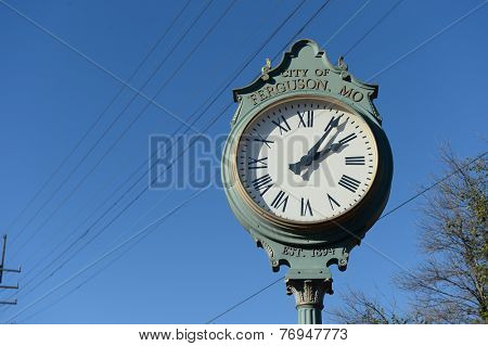 FERGUSON, MO/USA - NOVEMBER 25, 2014: Clock in the City of Ferguson in the aftermath of riots