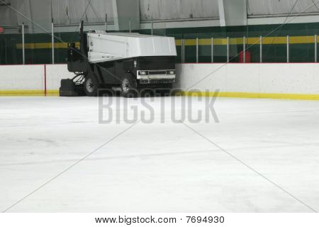 Ice Resurfacing machine smoothing ice in skating rink
