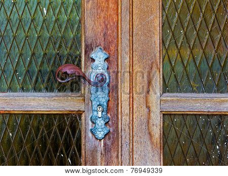 Iron Door Handle On Old Wooden Door