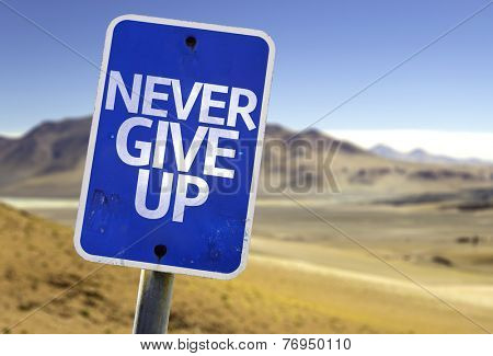 Never Give Up sign with a desert background