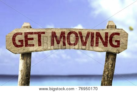 Get Moving sign with a beach on background