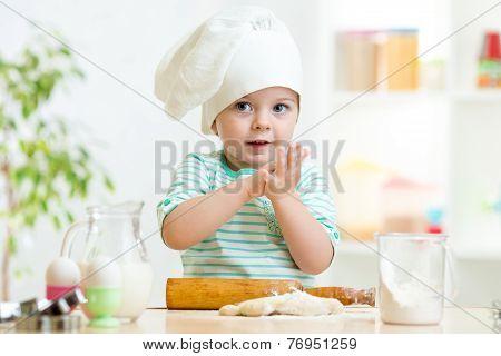 little baker child girl in chef hat