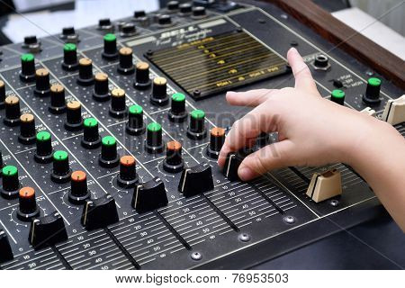 Audio sound mixer and child`s hand