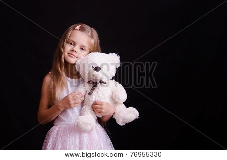 Portrait Of Happy Girl With A Soft Bear
