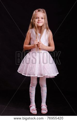 Portrait Of Happy Girl In White Dress