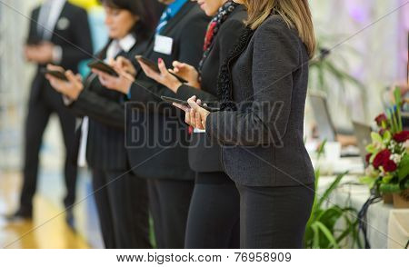 Business People With Tablets