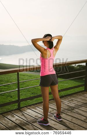 Female Athlete Getting Ready For Exercising