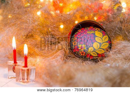 Christmas still life, Christmas arrangement with candles and boxes in Khokhloma painting