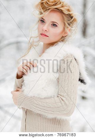Portrait of beautiful woman in winter forest