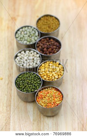 Different lentils in the small tumblers