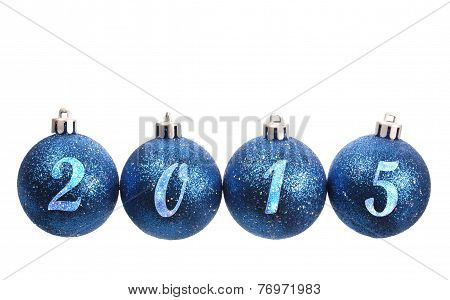 Four Blue Spangled Christmas Balls Arranged In The Year 2015